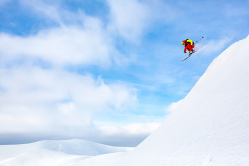 Fototapete - Good skiing day at the Carpathian mountains. Jumping. Fun.