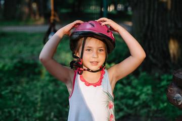 Portrait of lovely girl wearing pink helmet