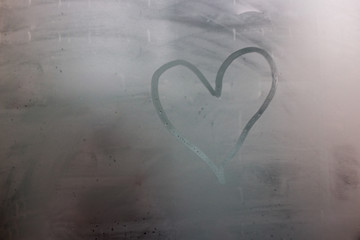 The drawing on the sweaty glass - heart