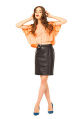 Young woman in black leather skirt and orange blouse