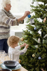 Christmas tree decoration with grandson