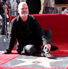 Director Murphy poses on his star after it was unveiled on the Hollywood Walk of Fame in Los Angeles