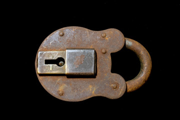 Rusty Vintage Padlock on Black Background