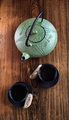 Cast iron tea set on wooden table