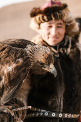 Mongolian Eagle Hunting. Portraits of hunters, falcons and horses. Wild face, unique ethnic costume, ethnic Kazakh, historical.