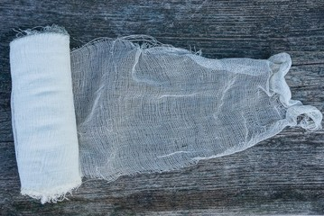 a skein of white gauze bandage on a gray table
