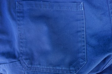 blue fabric texture of the pants with a pocket