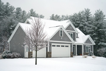 Winter house with woods in snow storm