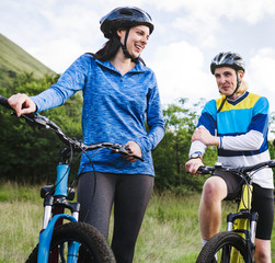 Cyclists in Glen Etive, Scotland