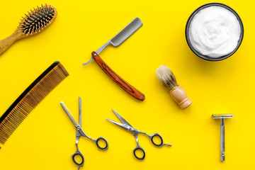 barbershop desk with tools for male care yellow background top view