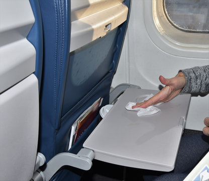 Wiping dirty airplane tray