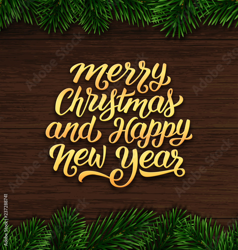 merry christmas and happy new year wishes on vintage wood background with fir tree branches border