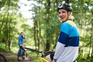 Happy blond cyclist on a bike