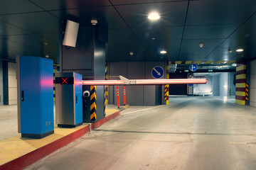 Barrier at entrance to underground parking garage Fototapete