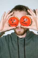 Young man with halloween donuts
