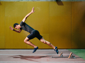 Man sprinting in gym