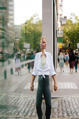 attractive young blonde woman smiling and playing with reflections
