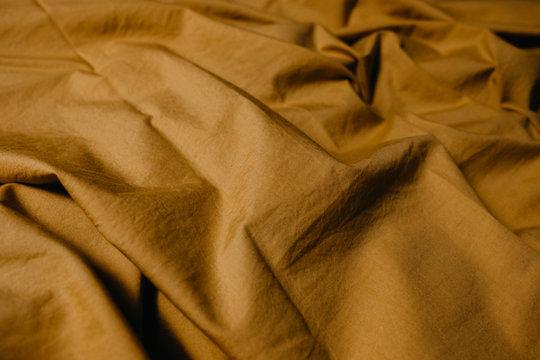 wrinkled ocher cloth