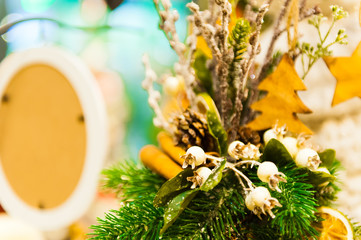 Christmas Fir Tree Toys Old wooden star hanging on branch Burning Candles, Boxes, Balls, Pine Cones, Walnuts, Branchesin the background other decorations and garlands. copy space.