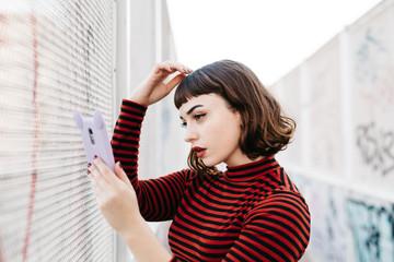 Woman adjusting her bangs