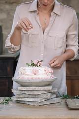 Person decorating Pavlova cake
