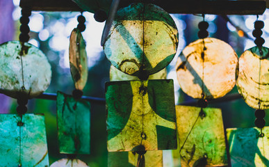 Glass wind chimes glowing in the evening light