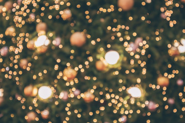 Abstract christmas holiday with festive gold bokeh light on tree blurred background