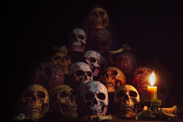 Pile of Skulls and bones Lighting by candlelight / Still Life Image and dim light and adjustment color for background