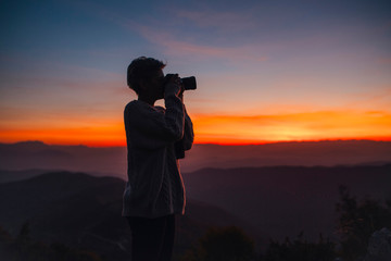 Woman shooting the sunset