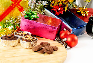 Chocolate brownie and cookei on wood plate with  Christmas decoration backgrounds