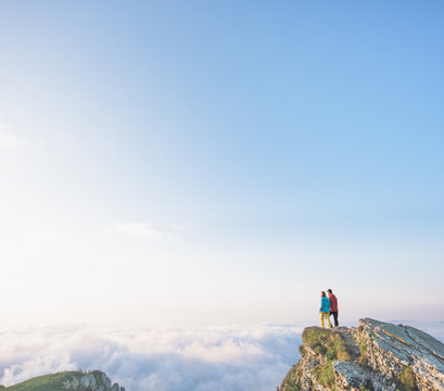 Hikers on top of the mountain admiring the majestic landscape