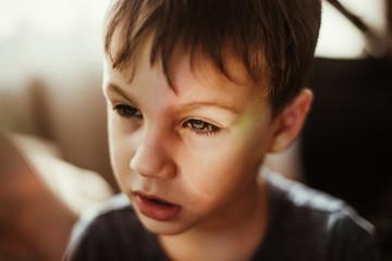boy on a a rainbow light
