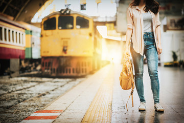 Woman traveler standing at train station
