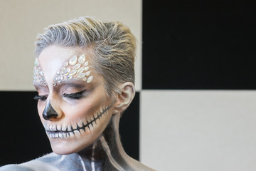 Girl Painted as an Skeleton. Halloween's Make-up.