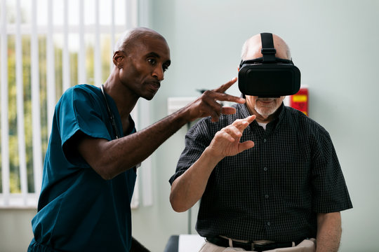 Exam: Senior Male Uses VR Headset To Look At Test Results