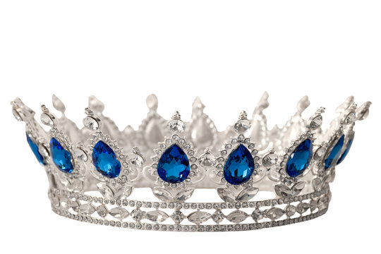 Beauty pageant winner, bride accessory in wedding and royal crown for a queen concept with a silver tiara covered in crystals, diamond and blue sapphire stones isolated on withe with clip path cutout
