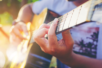 Close up of musician hand playing acoustic classical guitar.