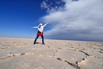 Iran, Tourist on the Great Salt Desert is a large desert lying in the middle of the Iranian plateau, Iran, near Khur (Khor