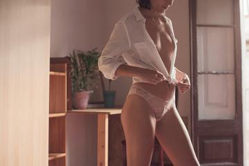 Sensual woman dressing up