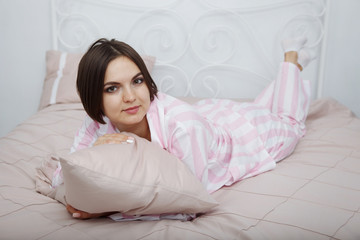 Young woman in pajamas.