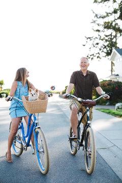 Healthy, active couple enjoying life riding cruiser bikes in sun