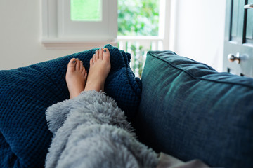 young woman's feet on sofa