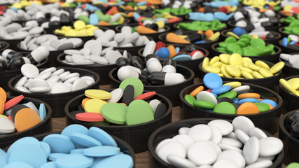 Colorful drug pills in lids