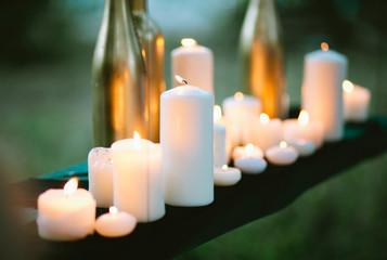 Tilt-shift photo of assorted burning candles