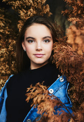 Portraits of young female against old tree