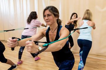 Senior women training in the gym