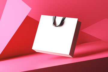 White bag with black handles isolated on a red background consisting of triangles. Mock Up. 3d rendering