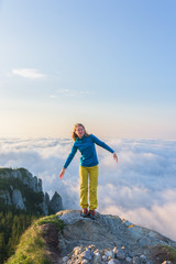 Female hiker standing on top of the mountain
