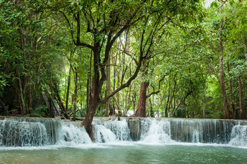 Beautiful and Breathtaking green waterfall at the tropical rainforest, Erawan's waterfall, Located Kanchanaburi Province, Thailand