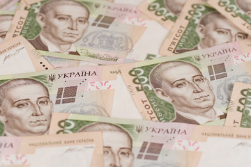 A close-up of a pattern of many Ukrainian currency banknotes with a par value of 500 hryvnia. Background image on business in Ukraine.